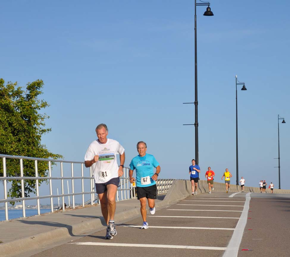 Photo Of Runners on Bridge