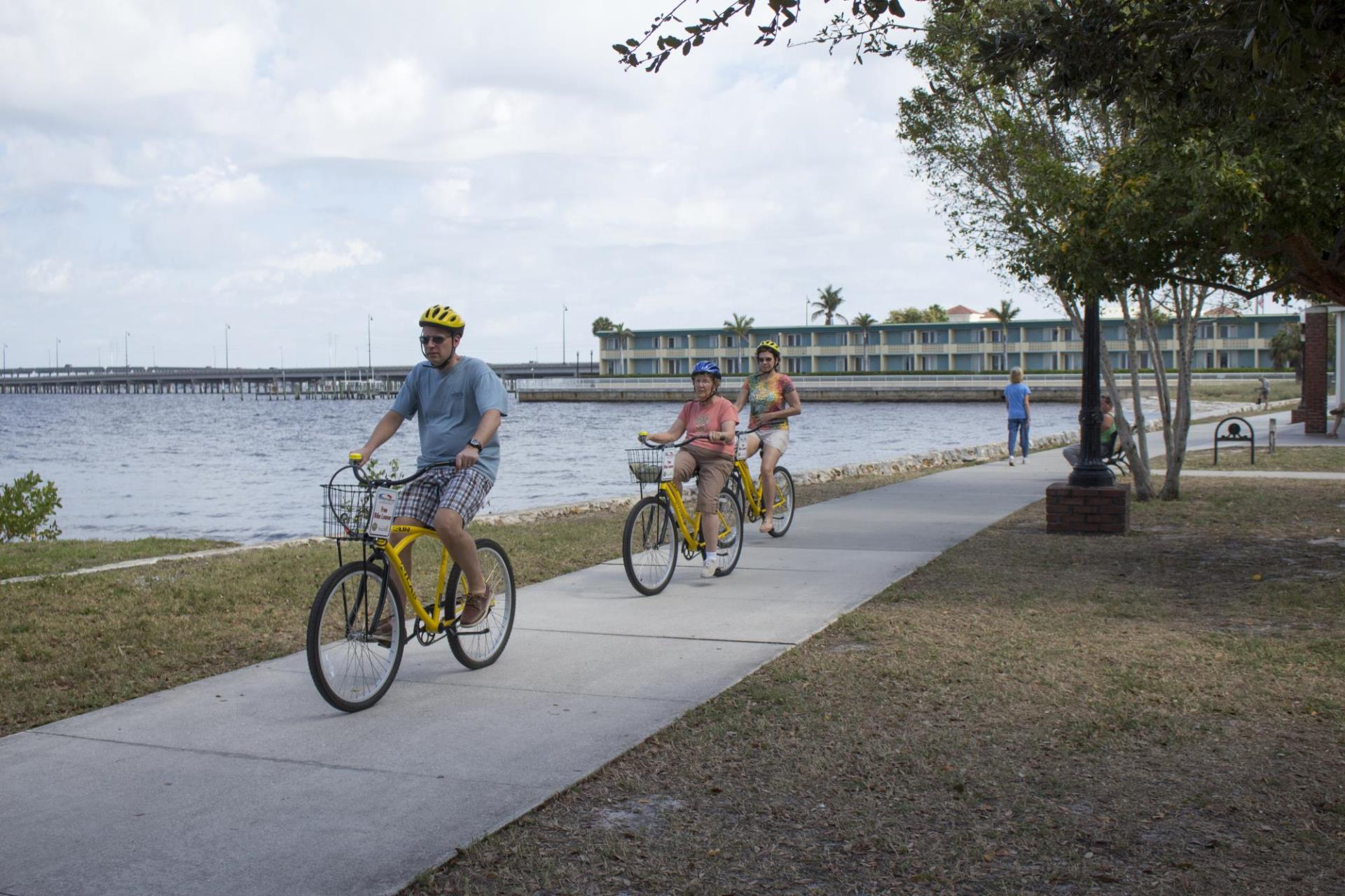 people biking along harbor at gilchrist park