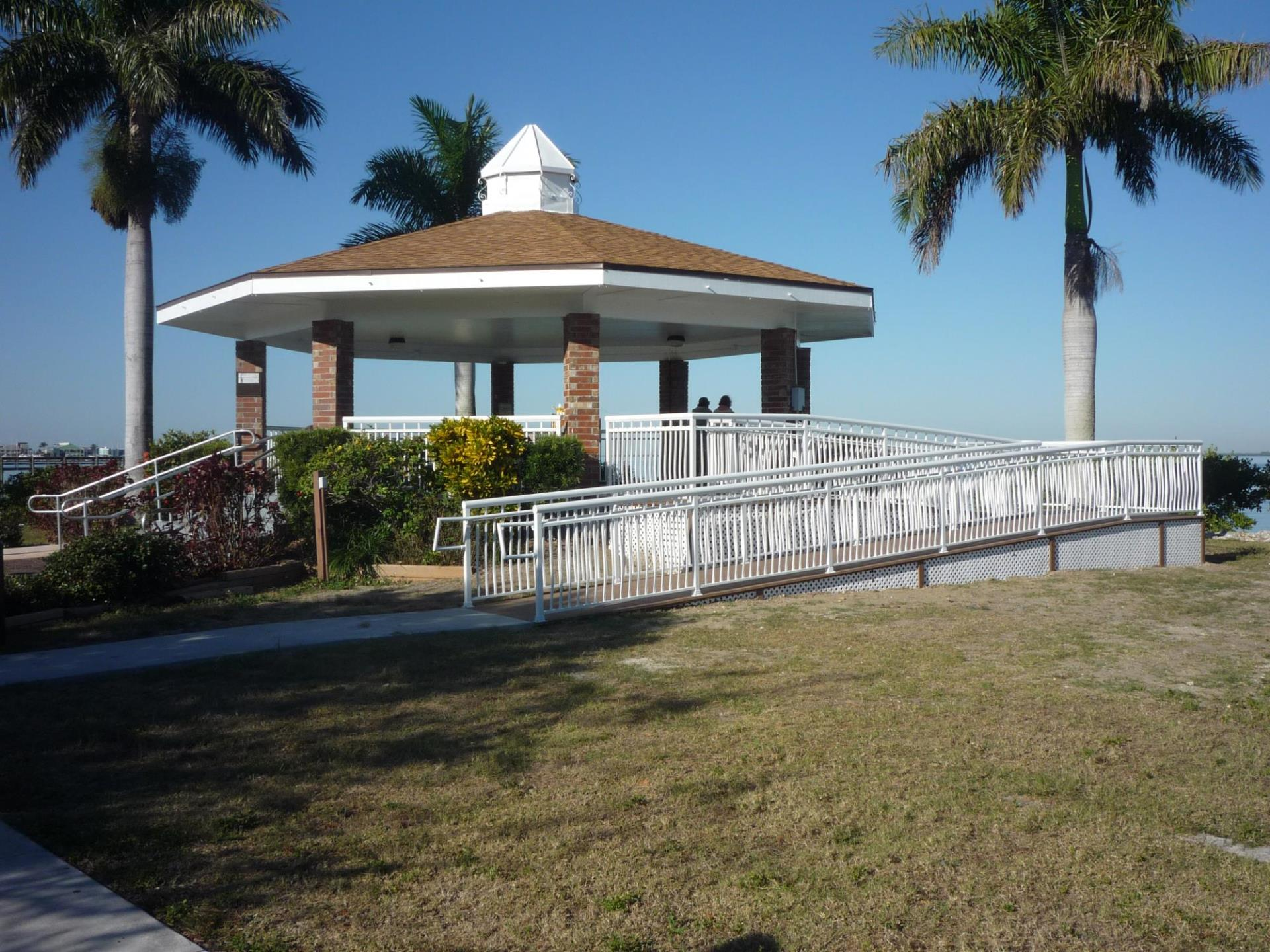gazebo with people in it along the harbor