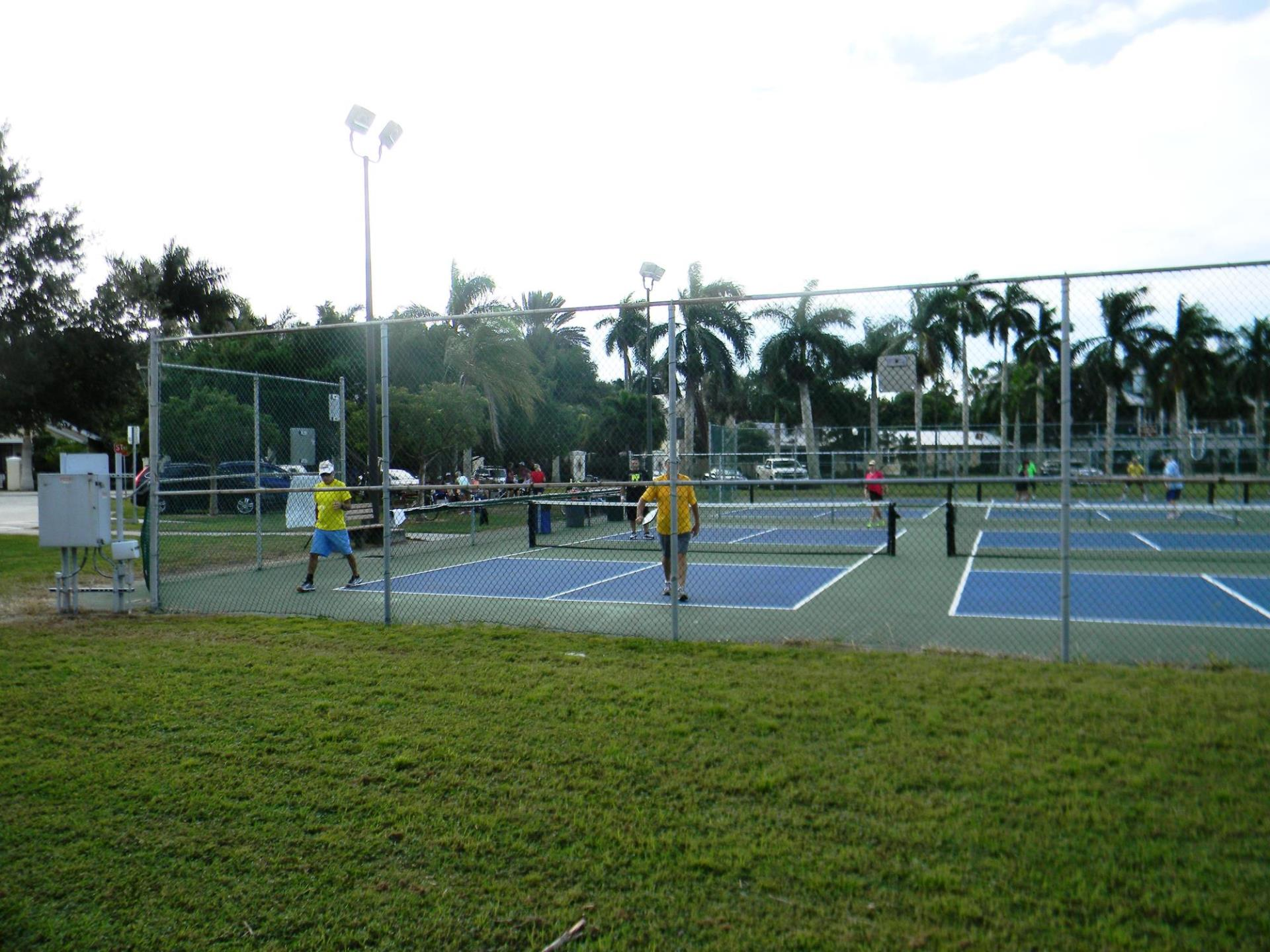 people playing pickleball in pickleball courts in gilchrest park