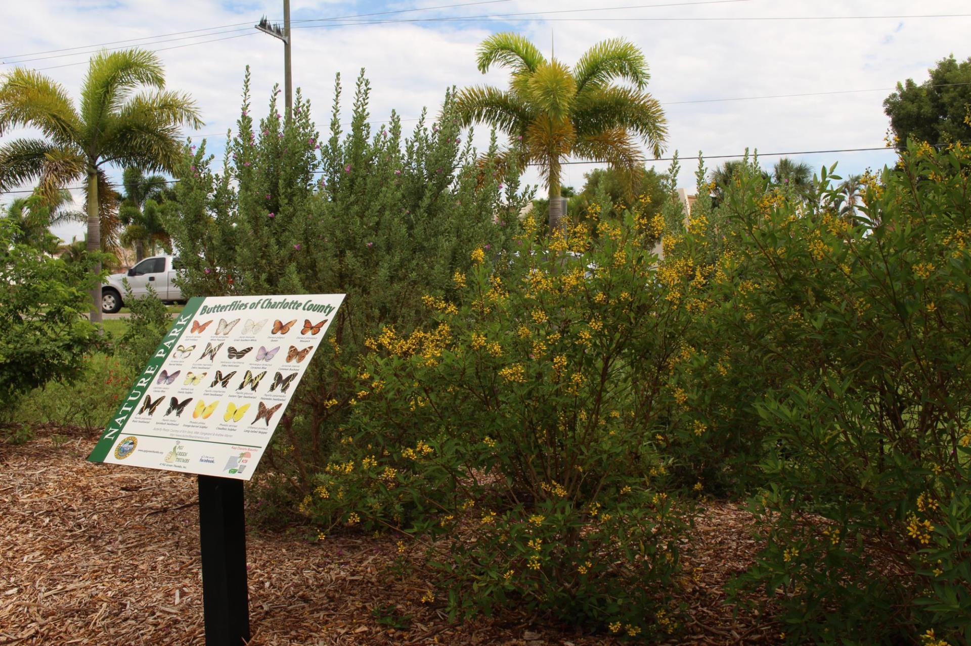 nature park with sign of butterflies of charlotte county