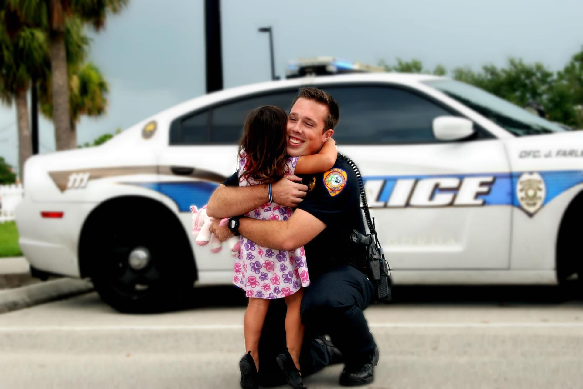 Officer Farley Hugging Child