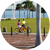 Photo of two individuals riding bikes